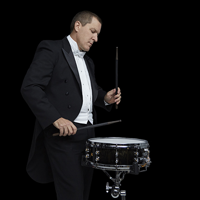 James Babor playing snare in tuxedo