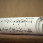 Close up of rolls of sheet music