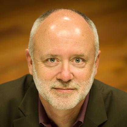 Rick Schmunk in black shirt looking into camera