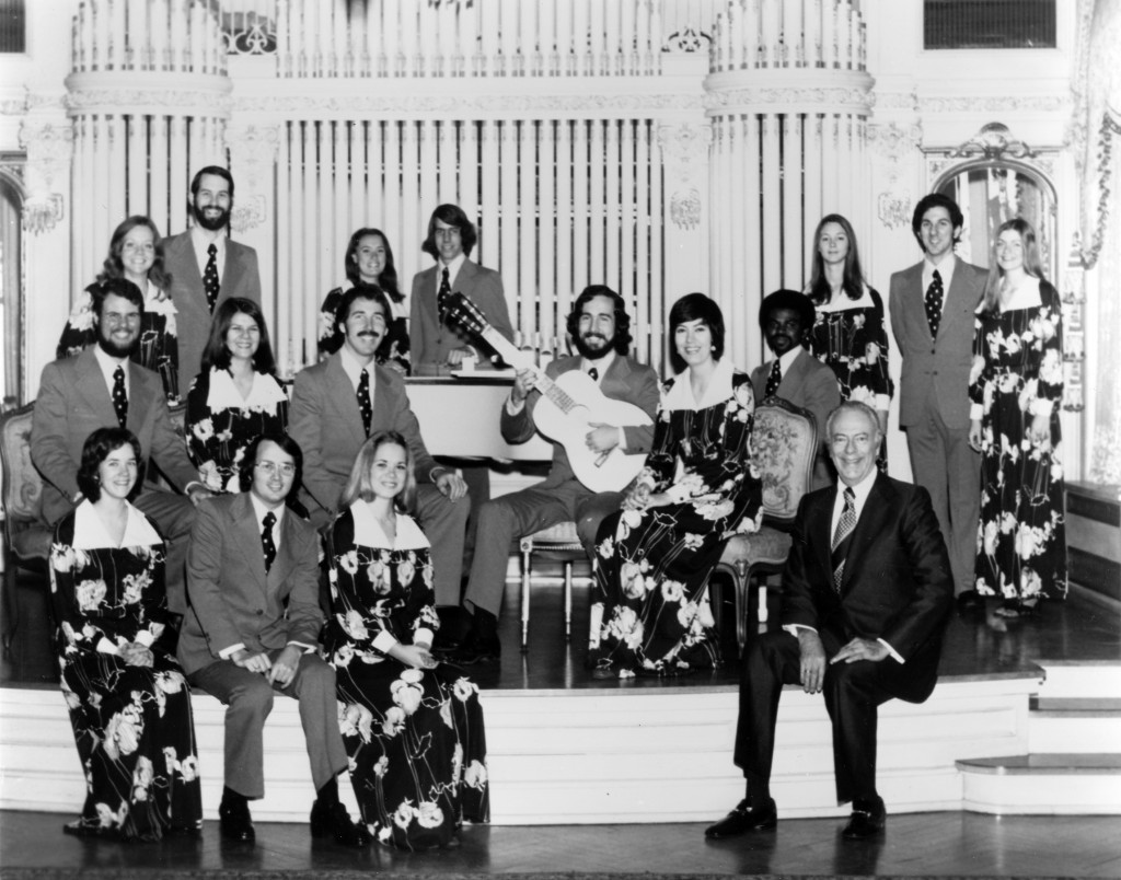 USC Chamber Singers, 1975. Dr. Charles H. Hirt is seated in the front row, far right. Donald Crockett, current Composition Department chair, is seated with the guitar.