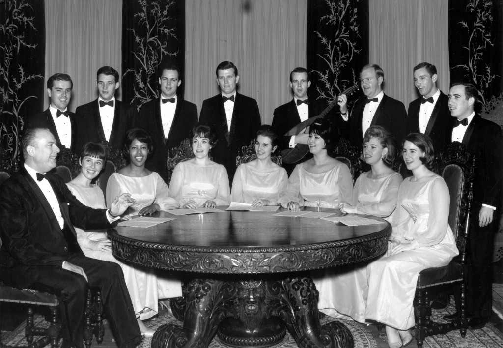 USC Chamber Singers, 1965-1966 academic year. Back Row (L to R): Stephen Sweetland, Del Shilling, Hedley Nosworthy, John Lilley, Doug Lawrence, Joe Stanford, Wayne Kuhaupt, Charlie Parker Front Row (L to R): Dr. Charles Hirt, Glenellen Cooper, Lorraine Doggett, Rose Fickas,  Amanda de Rycke Nina Hinson, Darlene Lawrence, Anne Sheldon