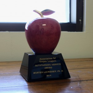 The Red Apple statuette has been presented to every winner of the Leagues' award since 1997.