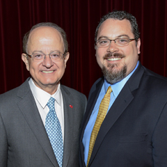 USC President C.L. Max Nikias, left, with The Steven B. Sample Teaching & Mentoring Award winner Paul Young during the USC Parents Association Presidents speech during Trojan Family Weekend, Friday, November 14, 2014. (USC Photo/ Gus Ruelas)