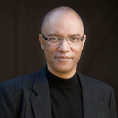 Formal portrait of Billy Childs dressed in black
