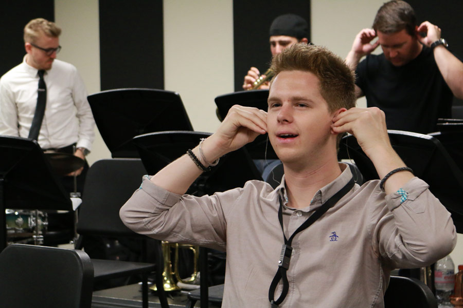 Alex Hahn tries out a pair of Etymotic earplugs. (Photo/Daniel Anderson)
