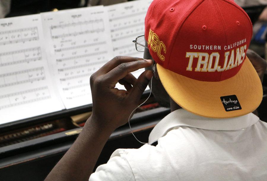 Paul Cornish (BM '18, jazz studies) tries on a pair of Etymotic earplugs designed for musicians. (Photo/Daniel Anderson)