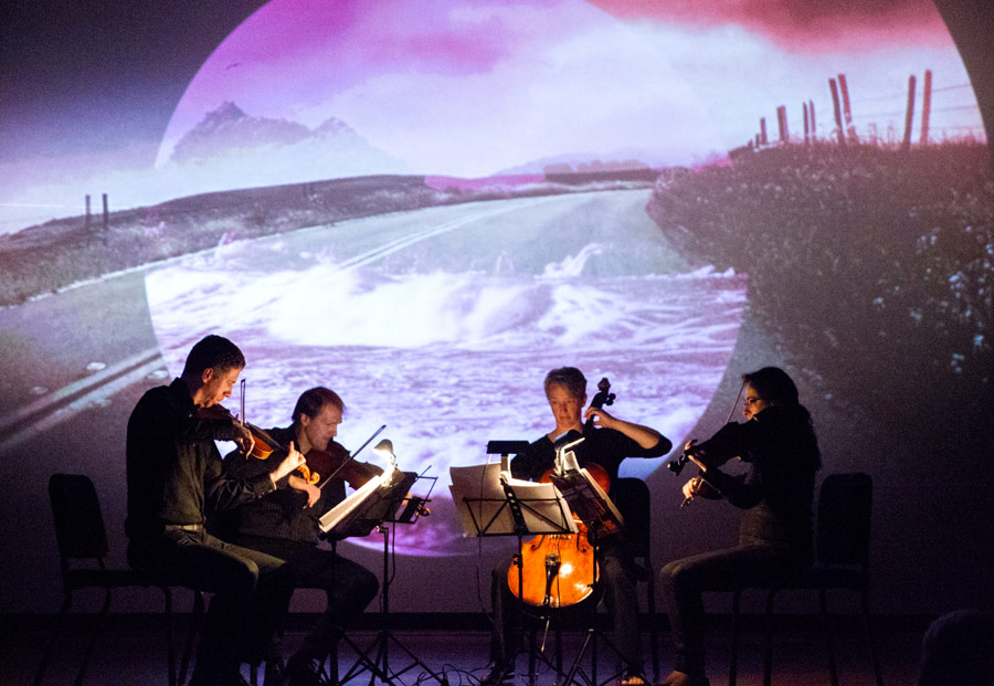 "The Penderecki String Quartet performs Jeffrey Holmes' ""Kirugi"" to an animation by Mike Patterson & Candace Reckinger (Photo/Mike Patterson)"