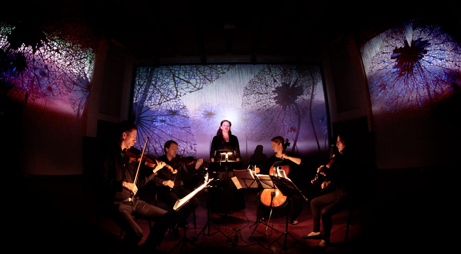 "The Penderecki String Quartet and soprano Rebekah Barton perform Veronika Krausas' ""midaregami"" to an animation by Mike Patterson & Candace Reckinger (Photo/Mike Patterson)"