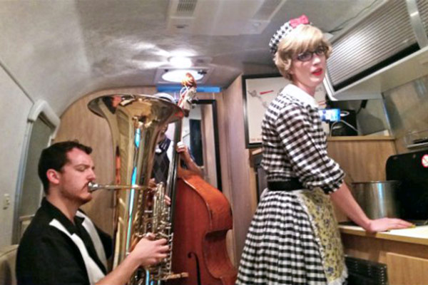 Thornton student Brandon Davis (tuba) in his Airstream trailer scene with alumna Victoria Fox, performing music by Veronika Krausas. (Photo/Jim Farber)