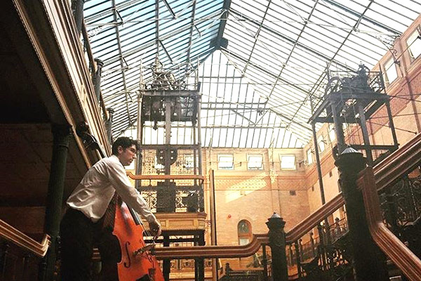 Thornton jazz alumnus Patrick Taylor takes his spot at the top of the Bradbury Building atrium. (Instagrammer @srhwnt)