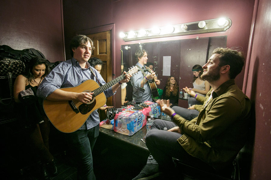 Guitarist and songwriter Alex Rosenbloom, left, and bass player Mackin Carroll, right, join other performers in the Troubadour's dressing room. (USC Photo/David Sprague)