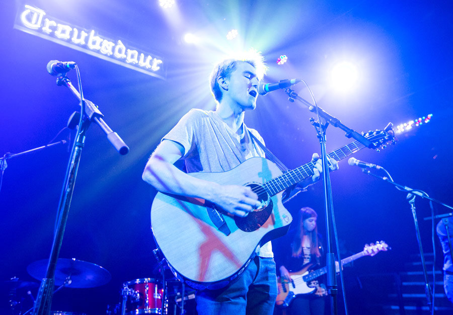 Singer Chase Kroesche performs under the often-photographed Troubadour neon sign. Emily Rosenfield plays bass at right. (USC Photo/David Sprague)