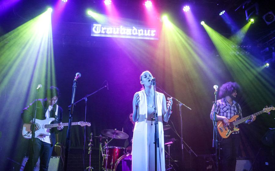 Singer Brooke Randol is accompanied by guitarist Jonny Sim, left, bass player Brian Jones, right, and drummer India Pascucci. (USC Photo/David Sprague)
