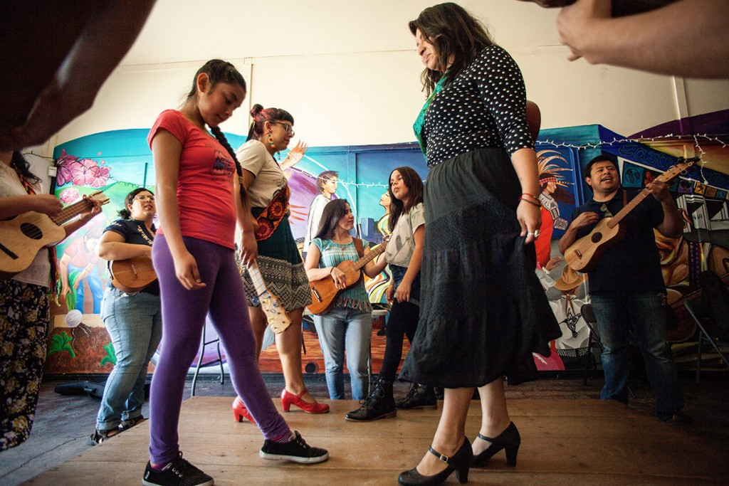 Flores leads the group in a lively zapateado (dance).Alejandra Ocasio and Laura Zavala, wearing zapateado shoes, dance with sisters Anxelli and Jah Bear. (Photo by Michael Becerra/Elefante Collective)