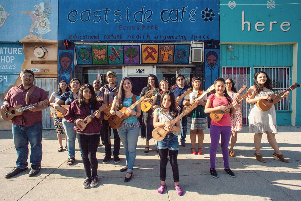Angela Flores and the members of the San Jarocho collective stand proudly outside of El Sereno's Eastside Café. Flores has helped to make the Café into a creative oasis for her community. (Photo by Michael Becerra/Elefante Collective)