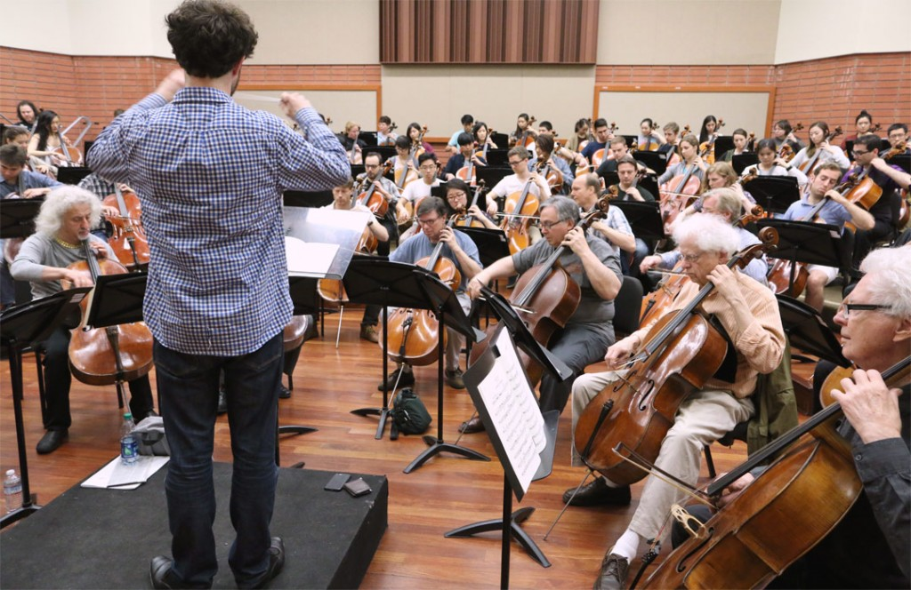 "An ensemble of over 100 cellists rehearsed at USC Thornton for their May 17th performance at Walt Disney Concert Hall of Anna Clyne's ""Threads and Traces."" (Photo by Evan Calbi/USC)"