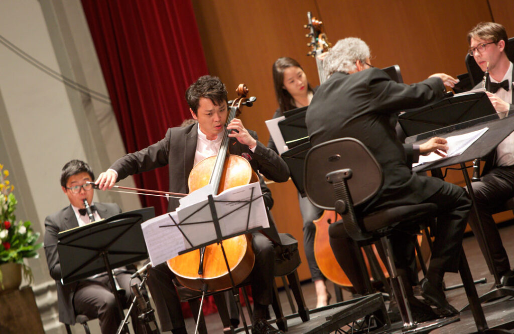 Cellist Li-Wei Qin performed Friedrich Gulda's Concerto for Cello and Wind Orchestra with the USC Thornton Wind Ensemble, under conductor Uriel Segal at USC's Bovard Auditorium on May 19. (Photo by Dario Griffin/USC)