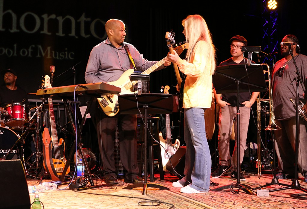 "Bassist Alex Al teaching the iconic bass line to Chic's ""Good Times"" to student Christine Meisenhelter."