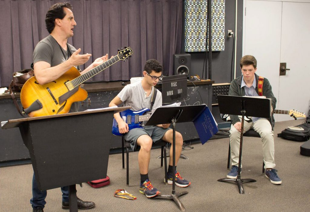 USC Guitar Seminar director Shea Welsh working with the 2016 class.