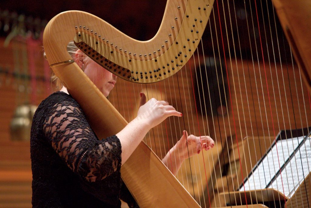 "A harpist prepares for Strauss's ""An Alpine Symphony."""