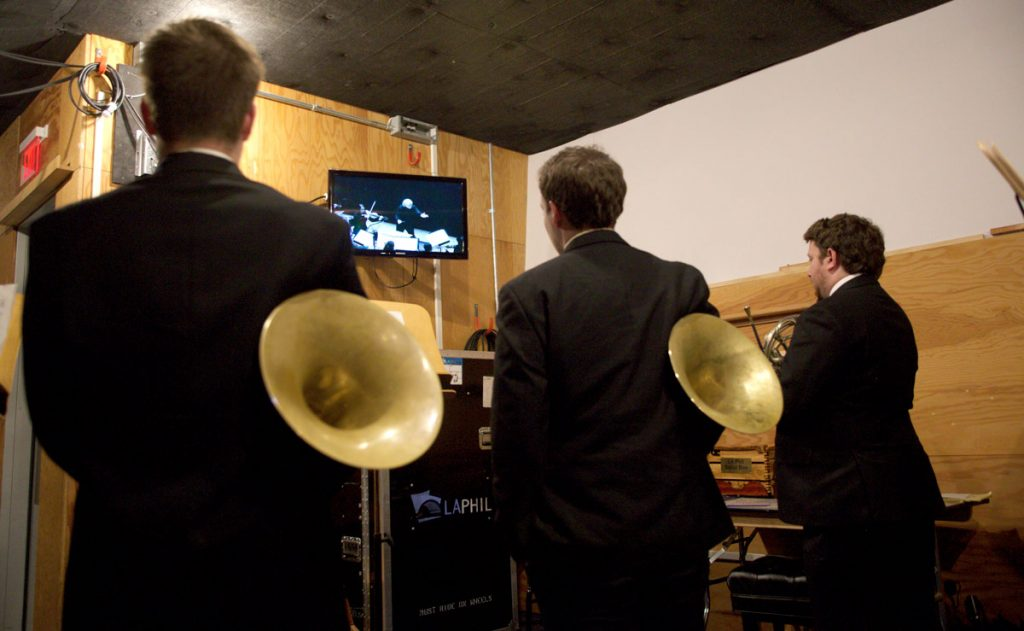 "The offstage horns await their cue during Strauss's ""An Alpine Symphony."""