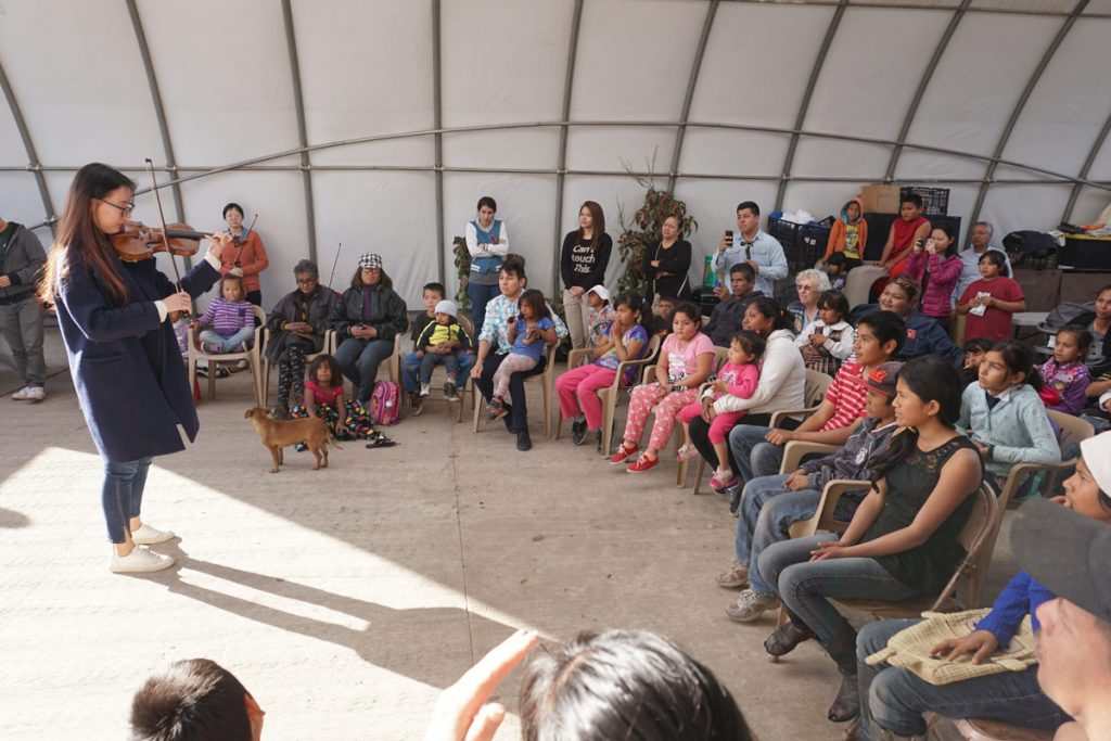 Performing in a community church outside of a dump in Tijuana. (Photo by Moises Encino)