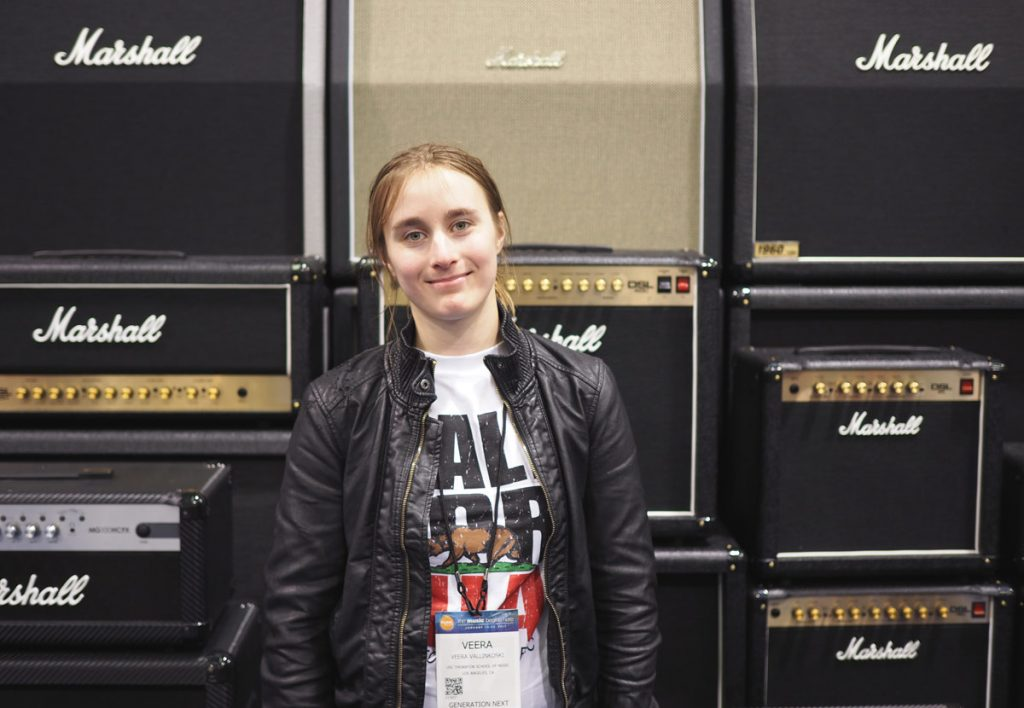 In front of a Marshall stack at the NAMM show. A wall of Marshalls - what's there not to love?
