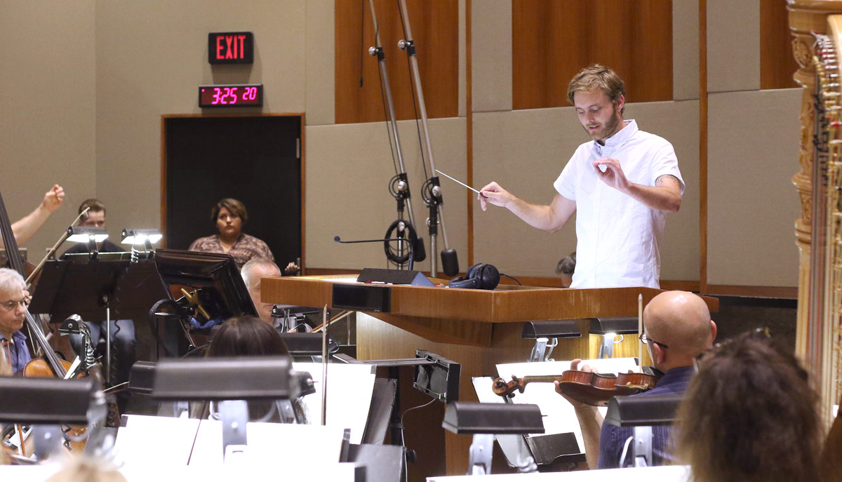 Duncan Thum conducts a 32-piece orchestra on July 22 as part of the annual BMI Conducting Workshop led by conductor and composer Lucas Richman. (Photo by Jc Olivera)