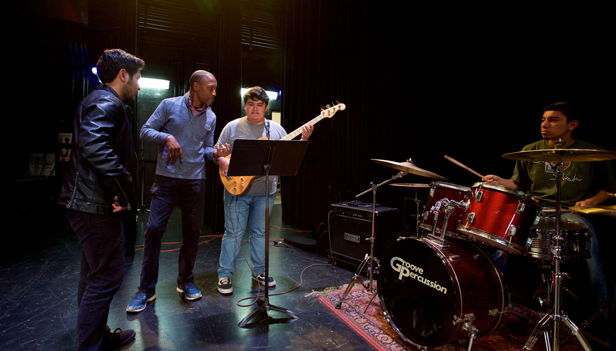 Educator Vince Womack works with jazz students