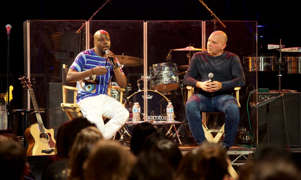 Musician and producer Wyclef Jean with Popular Music faculty member Tim Kobza at Carson Center.
