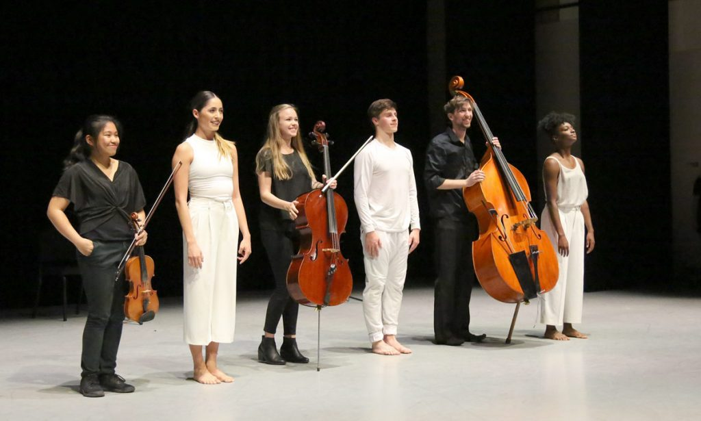 """Something About Time"" was choreographed by (left to right, in white) Mariana Carrillo, Adam Vesperman, and Amaria Stern, with music by (in black) Sydney Mariano, Sophie Mantieu, and John Mietus."
