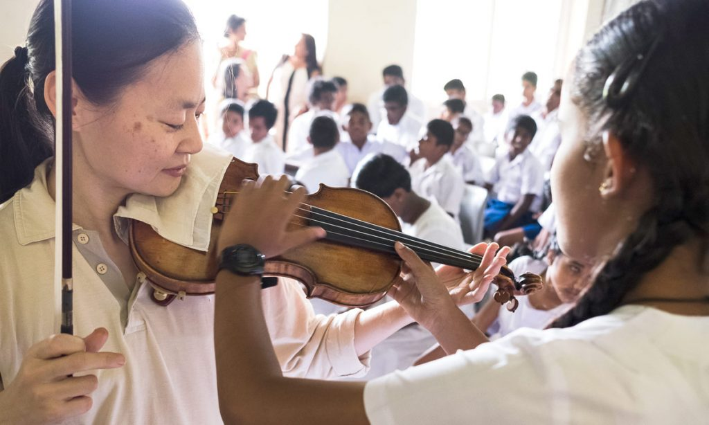 Last March, Midori Goto led a group of her USC Thornton students and alumni on an outreach trip to Sri Lanka. Here, she visits with a blind schoolgirl. (All photos by Luka Alagiyawanna, except where noted)