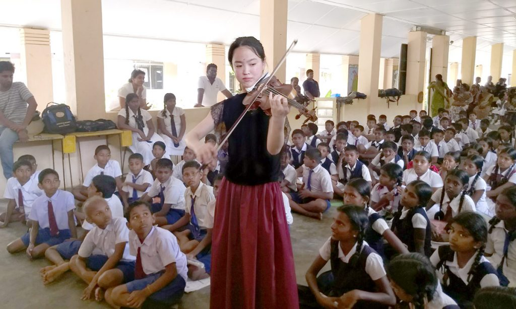 Chang He, a graduate student of Midori Goto, performs at a local school. (Photo courtesy of Moni Simeonov)