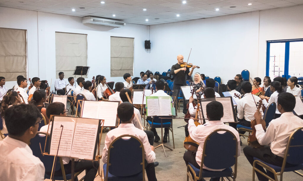 Moni Simeonov works with young musicians in a Sri Lankan youth orchestra.