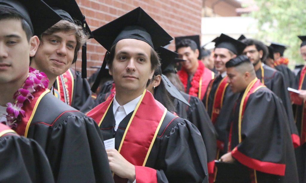 The graduates assemble.