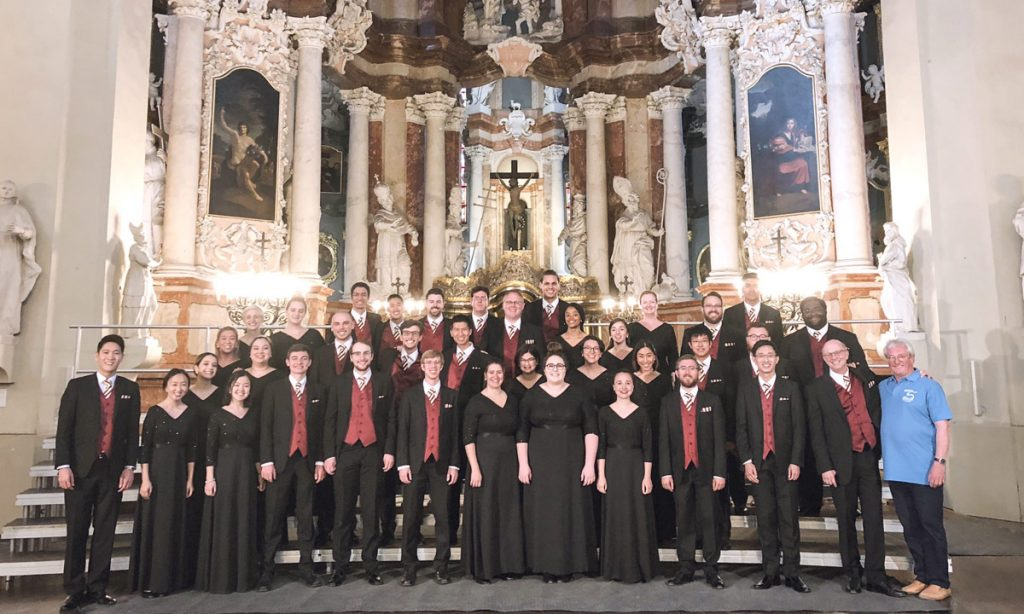 The Chamber Singers with Lithuanian composer Vytautas Miškinis (far right), who conducted the ensemble in his own piece at the Church of St. Johns in Vilnius.