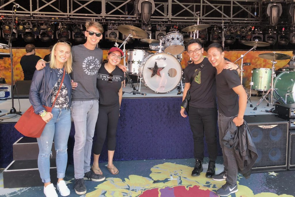 USC Thornton Music Industry students stand next to Ringo Starr's drumkit on stage at the Greek Theatre in Los Angeles. L-R: Katie Middleton, Charlie Smith, Celine Torkan, Shuiada Zeng and Joe Pinzon.