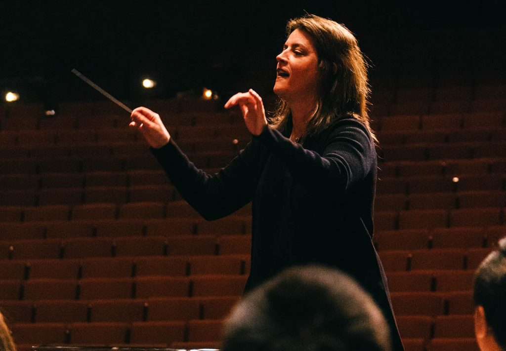 Sharon Lavery lead the USC Thornton Wind Ensemble at CBDNA 2019. (Photo by Chris O'Brien)