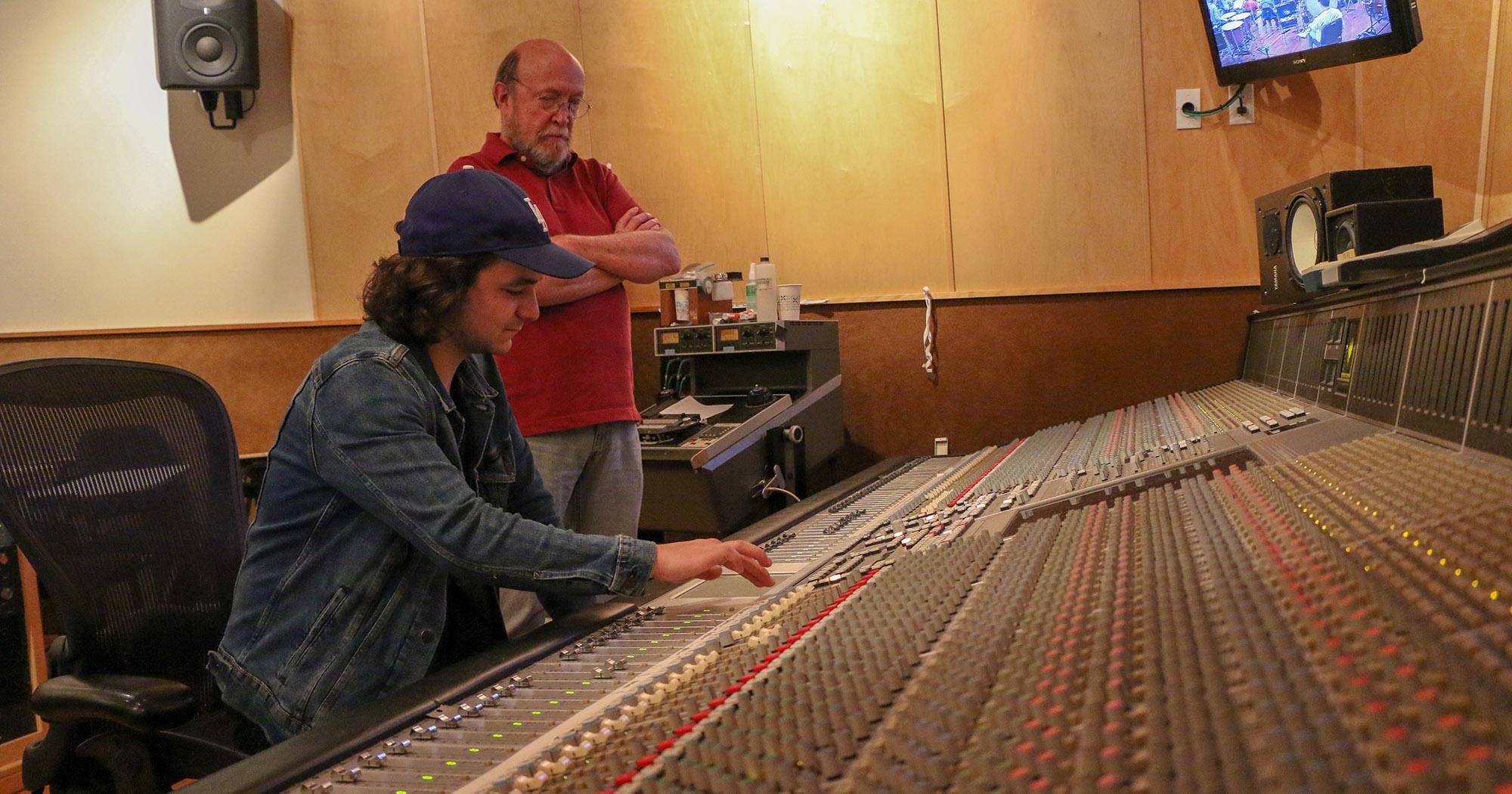 Joey Messina-Doerning (left) recording the USC Thornton Symphony while Richard McIlvery advises.