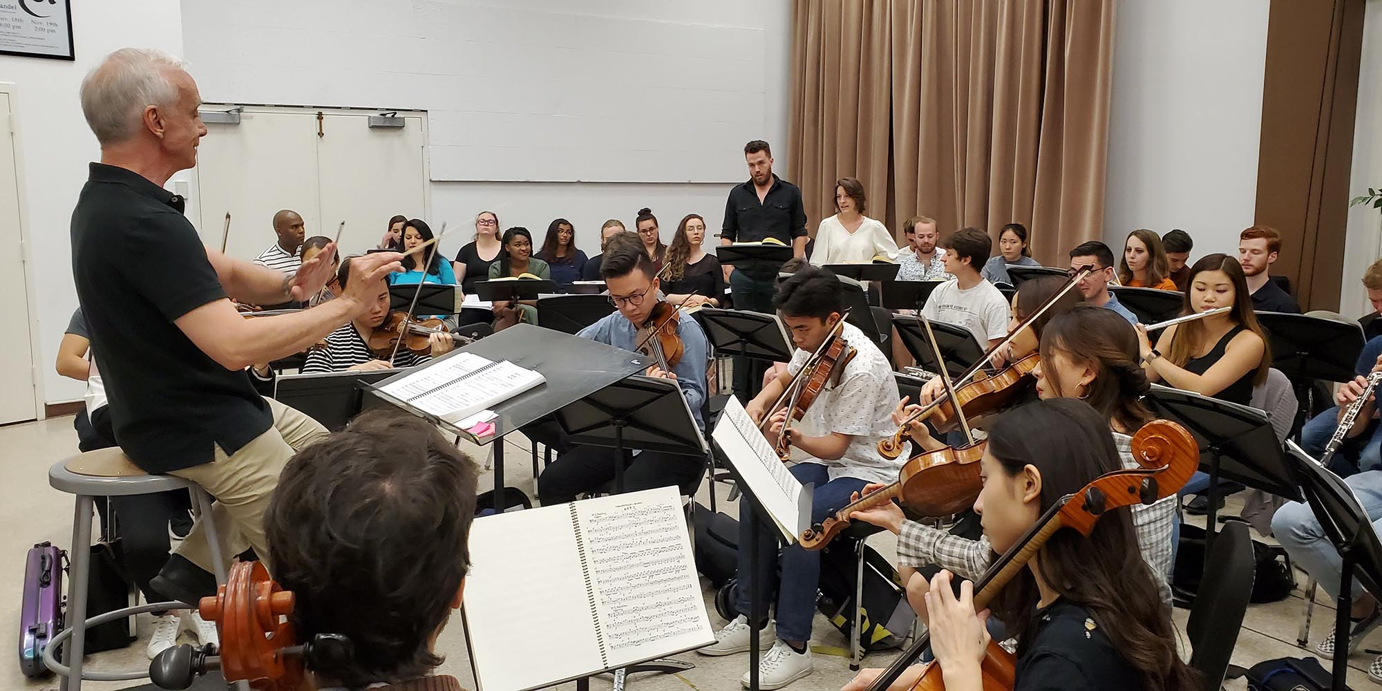 "Brent McMunn leads the USC Thornton Opera and Symphony in a rehearsal of ""Le nozze di Figaro."""