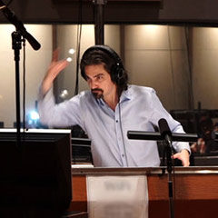 Photo of Bear McCreary in studio, conducting