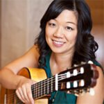 Photo of Connie Sheu with guitar