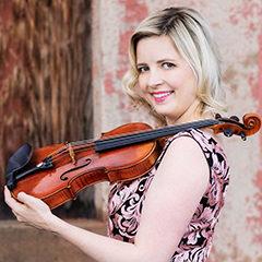Photo of Kathryn Eberle holding violin