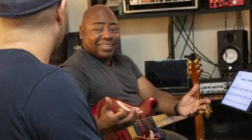 Photo of Paul Jackson Jr. teaching a student
