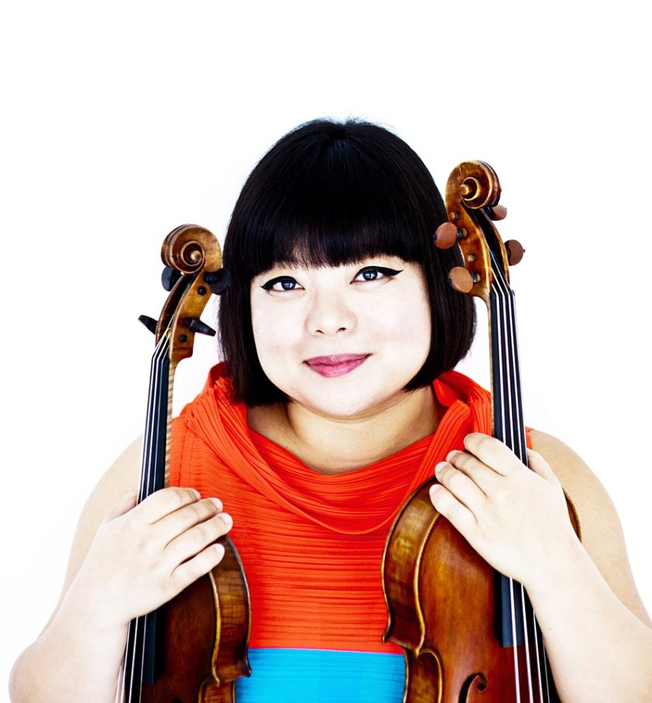 Photo of Yura Lee holding violin and viola