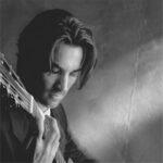 Photo of Daniel Smythe with guitar