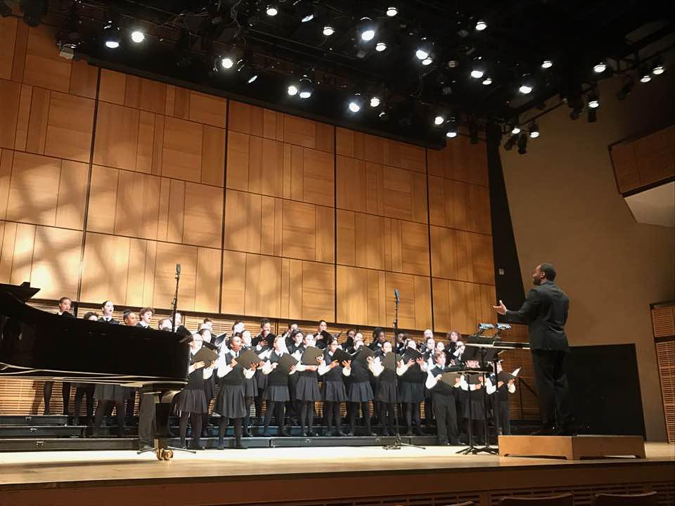 Alex Blake conducting children's choir