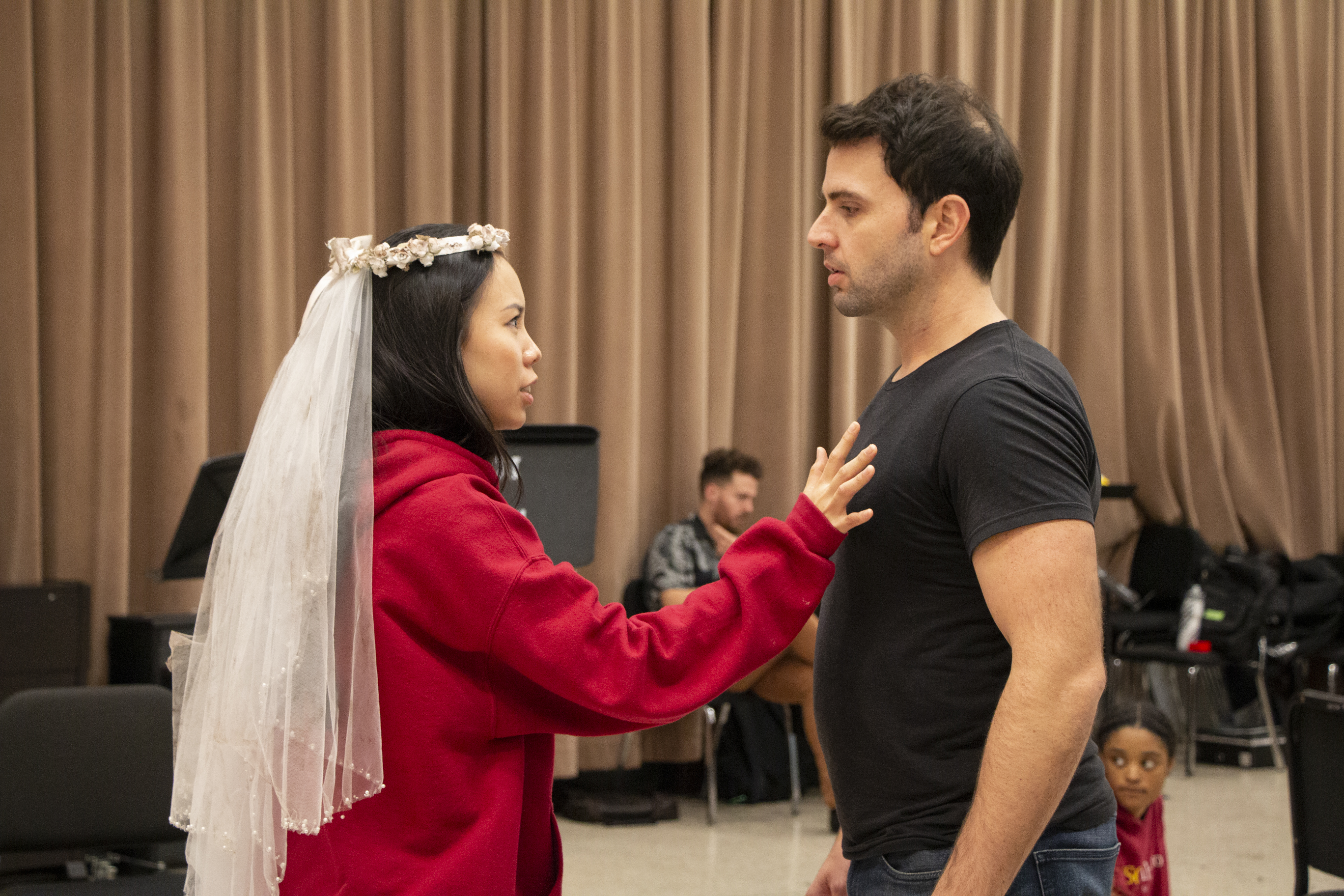 Photo of two opera cast members in rehearsal