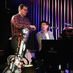 Photo of John Storie with Jeff Goldblum rehearsing