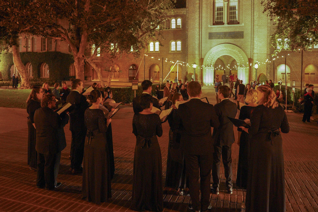 USC Thornton Chamber Singers singing carols for guests arriving at the Winter Gala